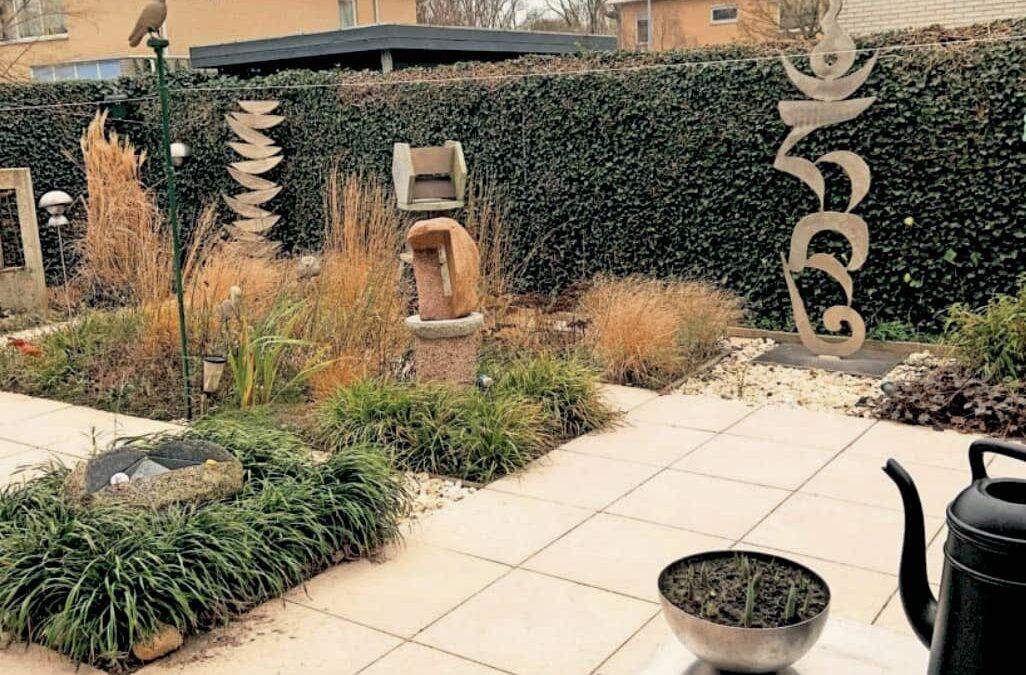 Een tuin die opgaat in het duinlandschap