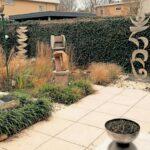 Foto een tuin die opgaat in het duinlandschap - Piek hoveniers